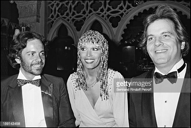 AlainPhilippe Malagnac Amanda Lear and Massimo Gargia attend a party at night club 78 in Paris in 1979