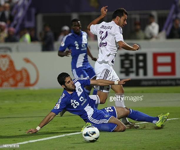 Al-Ain's Alex Brosque vies for the ball against Al-Hilal 's Almarshadi during their AFC Champions League group D football match at the Sheikh Tahnoun...