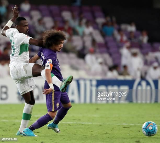 AlAin's captain Emirati midfielder Omar Abdulrahman vies for the ball with AlAhli's Saudi defender Motaz Hawsawi during their AFC Champions League...