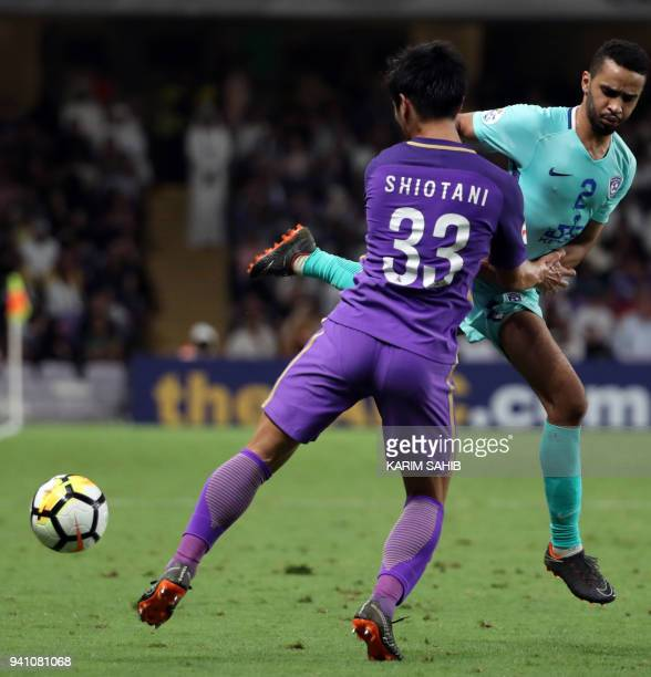 AlAin's defender Tsukasa Shiotani vies for the ball with AlHilal's defender Mohammed AlBreik during the AFC Champions League football match between...