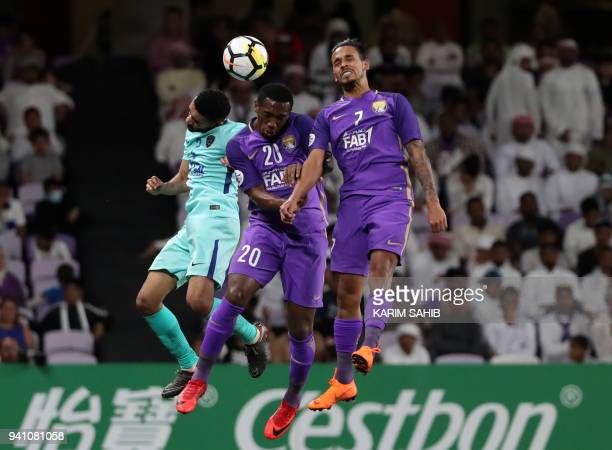 AlAin's forward Ahmed Khalil and midfielder Caio vie for the header with AlHilal's defender Mohammed AlBreik during the AFC Champions League football...