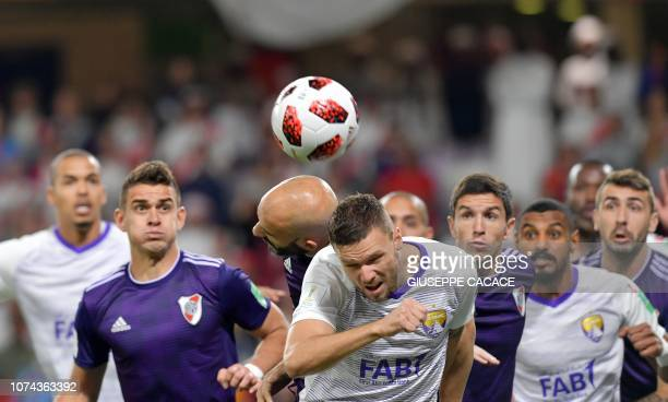 AlAin's forward Marcus Berg heads the ball before scoring a goal during the semifinal football match of the FIFA Club World Cup 2018 tournament...