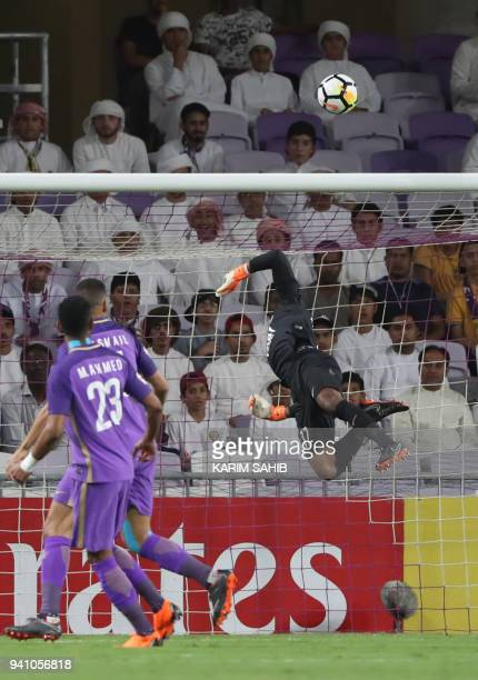 AlAin's goalkeeper Khalid Eisa knocks the ball over the crossbar during the AFC Champions League football match between UAE's alAin and Saudi's...