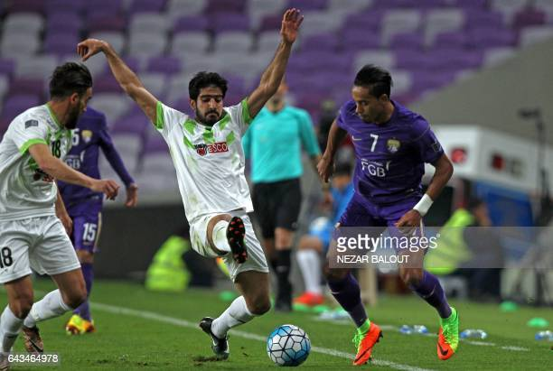 AlAin's Lucas Fernandes Caio tries to tackle as Zobahan's Ali Hamam and Mohammad Nevada engage in an action during the AFC Asian Champions League...