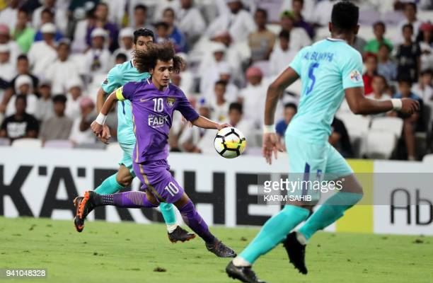 AlAin's midfielder and captain Omar Abdulrahma runs with the ball during the AFC Champions League football match between UAE's alAin and Saudi's...