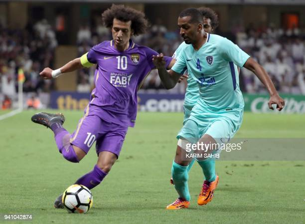 AlAin's midfielder and captain Omar Abdulrahma vies for the ball with alHilal's defender Abdullah AlZori during the AFC Champions League football...