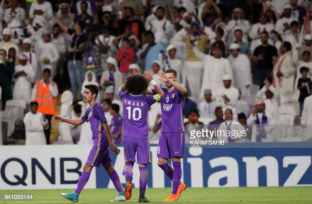 AlAin's midfielder and captain Omar Abdulrahman congratulates his teammate Marcus Berg following his goal during the AFC Champions League football...
