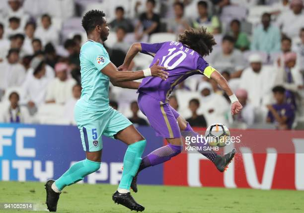 AlAin's midfielder and captain Omar Abdulrahman is fouled by alHilal's defender Ali alBulaihi during the AFC Champions League football match between...