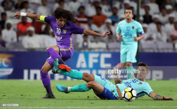AlAin's midfielder and captain Omar Abdulrahman vies for the ball with alHilal's midfielder Nicolas Milesi during the AFC Champions League football...