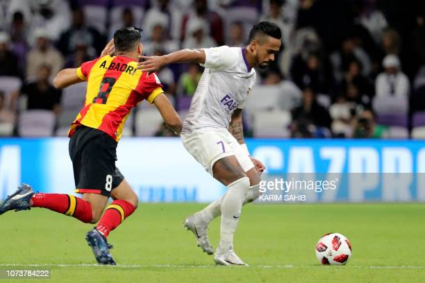 AlAin's midfielder Hussein elShahat fights for the ball with ES Tunis' forward Anice Badri during the second round match of the FIFA Club World Cup...
