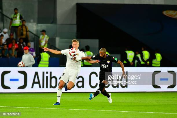 AlAin's midfielder Hussein elShahat fights for the ball with Real Madrid's Spanish midfielder Marcos Llorente during the FIFA Club World Cup final...