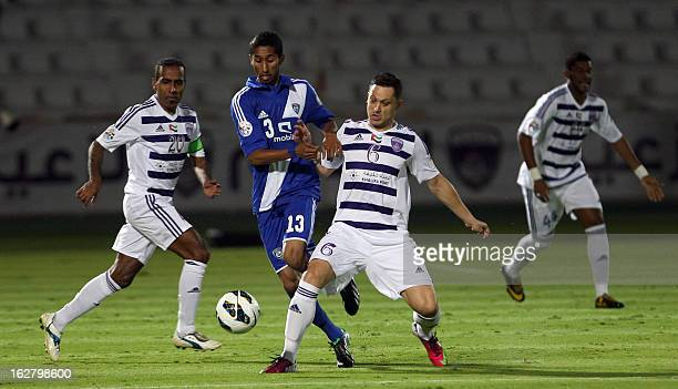 AlAin's Mirel Radoi vies for the ball against AlHilal 's Salam AlFaraj during their AFC Champions League group D football match at the Sheikh Tahnoun...