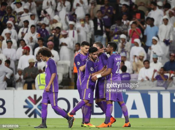 AlAin's players congratulate teammate Marcus Berg following his goal during the AFC Champions League football match between UAE's alAin and Saudi's...