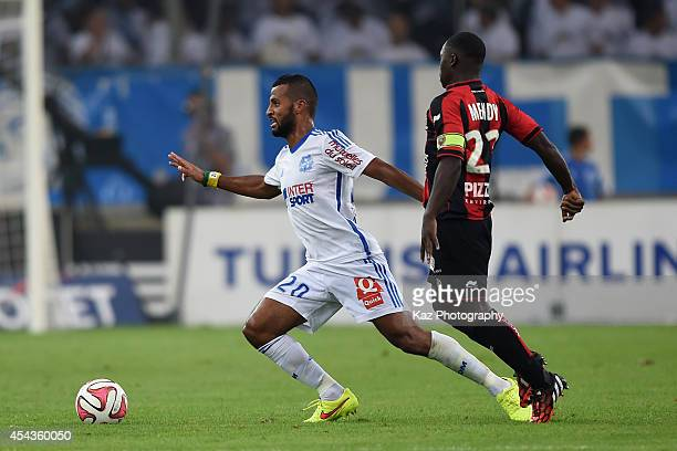 Alaixis Romao of Marseille and Nampalys Mendy of Nice compete for the ball during the French Ligue 1 match between Olympique de Marseille and OGC...