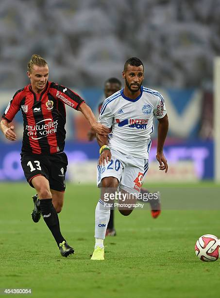 Alaixis Romao of Marseille and Niklas Hult of Nice compete for the ball during the French Ligue 1 match between Olympique de Marseille and OGC Nice...