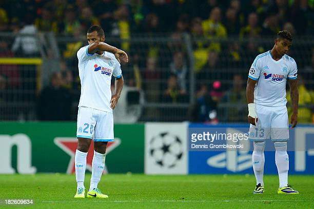 Alaixys Romao and Mario Lemina of Olympique Marseille look dejected during the UEFA Champions League Group F match between Borussia Dortmund and...