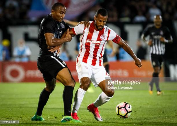 Alaixys Romao of Olympiacos in action against Leandre Tawamba of Partizan during the UEFA Champions League Qualifying match between FC Partizan and...