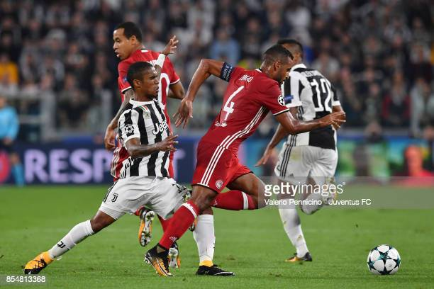 Alaixys Romao of Olympiacos in action during the UEFA Champions League group D match between Juventus and Olympiakos Piraeus at Allianz Stadium on...