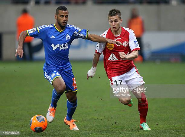 Alaixys Romao of OM and Nicolas de Preville of Stade de Reims in action during the french Ligue 1 match between Stade de Reims and Olympique de...