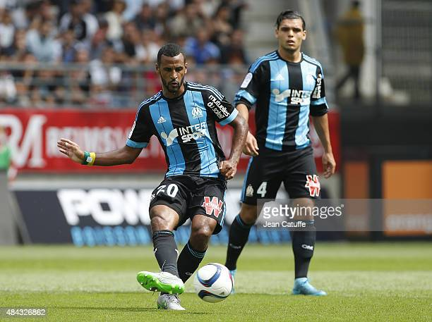 Alaixys Romao of OM in action while Karim Rekik of OM looks on during the French Ligue 1 match between Stade de Reims and Olympique de Marseille at...