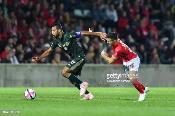 Alaixys Romao of Reims and Antonin Bobichon of Nimes during the Ligue 1 match between Nimes and Reims at Stade des Costieres on October 6 2018 in...