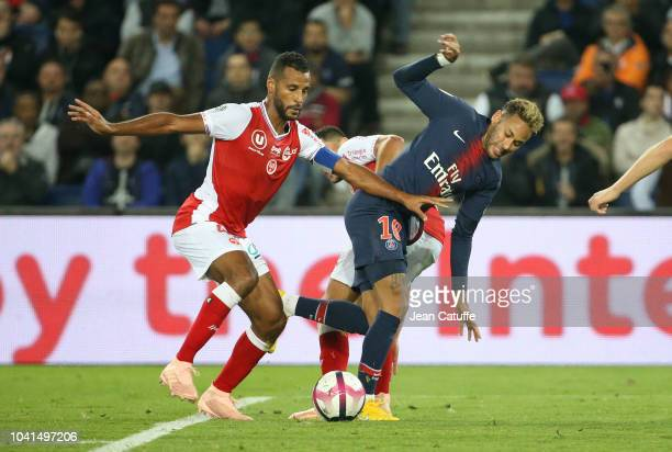 Alaixys Romao of Reims Neymar Jr of PSG during the french Ligue 1 match between Paris SaintGermain and Stade de Reims at Parc des Princes stadium on...