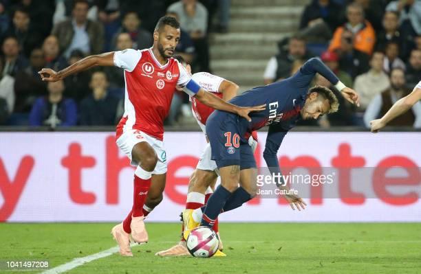 Alaixys Romao of Reims Neymar Jr of PSG during the french Ligue 1 match between Paris SaintGermain and Stade de Reims at Parc des Princes stadium on...