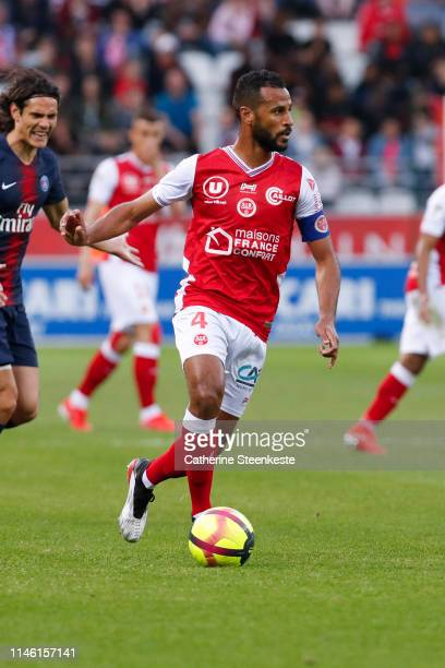 Alaixys Romao of Stade de Reims controls the ball during the Ligue 1 match between Stade de Reims and Paris SaintGermain at Stade Auguste Delaune on...