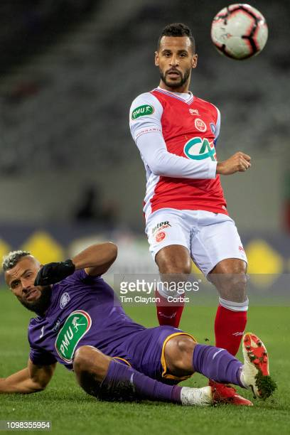 Alaixys Romao of Stade de Reims is challenged by John Bostock of Toulouse in action during the Toulouse FC V Stade de Reims Coupe de France match at...