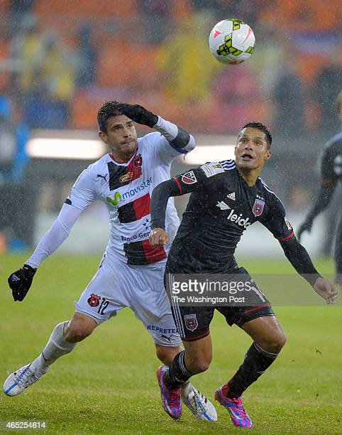 Alajuel's Jhonny Acosta left battles for the ball with United's Jairo Arrieta during DC United's defeat of Alajuela of Costa Rica 2 1 in the...