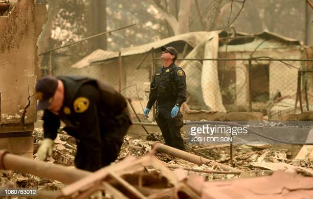 Alameda County Sheriff Coroner officers search for human remains at a burned residence in Paradise California on November 12 2018 Thousands of...