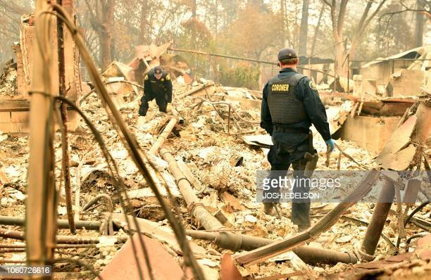TOPSHOT Alameda County Sheriff Coroner officers search for human remains after the Camp fire tore through the region in Paradise California on...