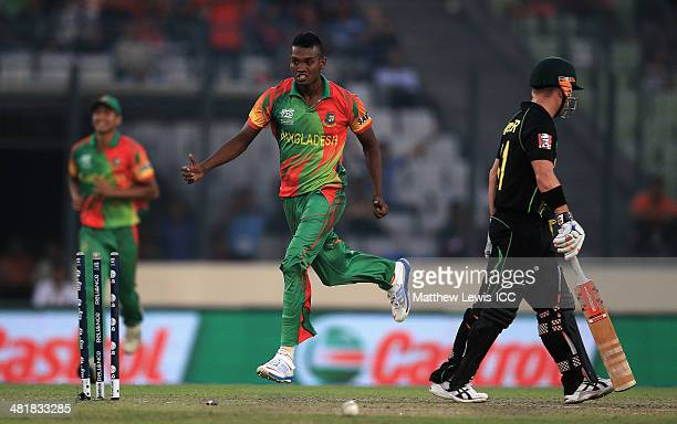 AlAmin Hossain of Bangladesh celebrates bowling David Warner of Australia during the ICC World Twenty20 Bangladesh 2014 match between Bangladesh and...