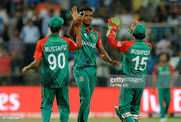 AlAmin Hossain of Bangladesh celebrates the wicket of Suresh Raina of India during the ICC World Twenty20 India 2016 match between India and...