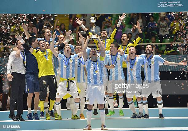 CALI COLOMBIA OCTOBER 01 Alamiro Vaporaki of Argentina lifts the winners trophy during the FIFA Futsal World Cup Final match between Russia and...