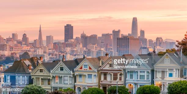 alamo square and painted ladies with san francisco skyline - san francisco california stock photos and pictures