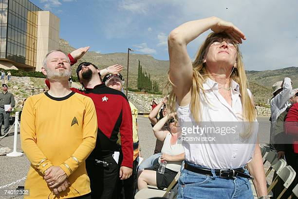 Star Trek fans Anna Hamilton of Santa Fe New Mexico father and son fans Will and Jared Steinsiek watch a missing man formation from Holloman Air...