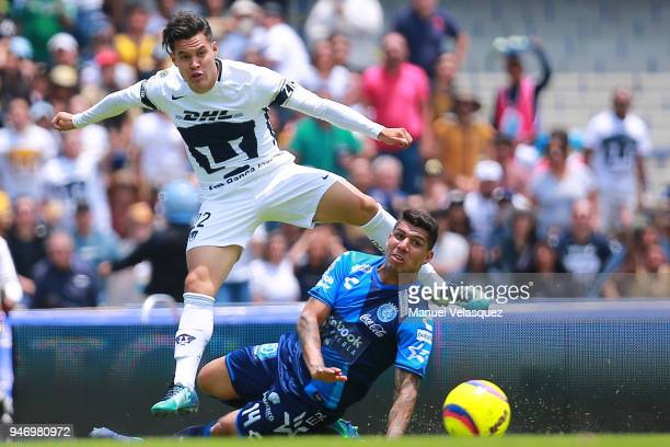 Alan Acosta of Pumas struggles for the ball against Erik Pimentel of Puebla during the 15th round match between Pumas UNAM and Puebla as part of the...
