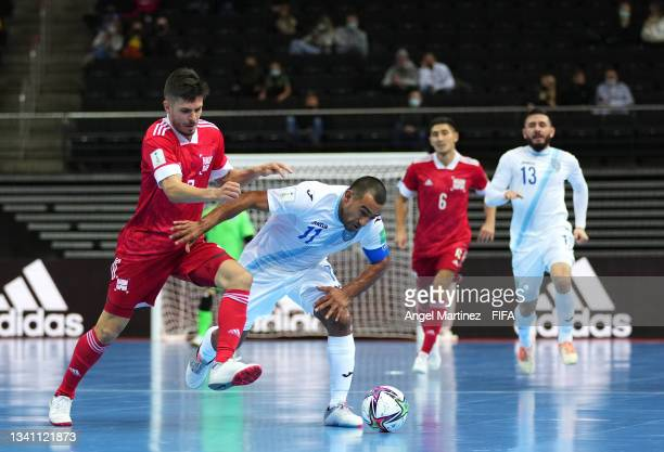 Alan Aguilar of Guatemala and Ivan Milovanov of RFU challenge for the ball during the FIFA Futsal World Cup 2021 group B match between Guatemala and...