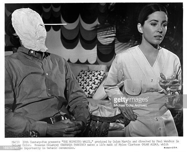 Alan Alda has life mask made of him by Barbara Parkins in a scene from the film 'The Mephisto Waltz' 1971