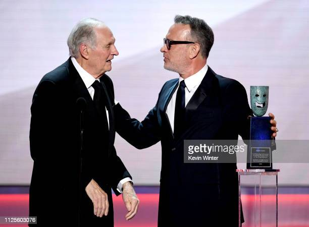 Alan Alda receives the SAG Life Achievemant Award from Tom Hanks onstage during the 25th Annual Screen Actors Guild Awards at The Shrine Auditorium...