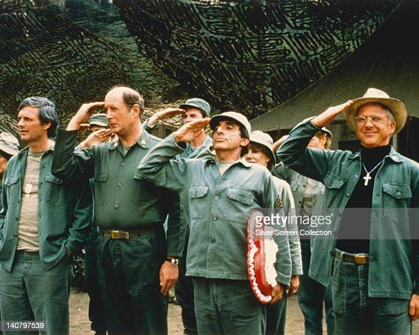 Alan Alda US actor David Ogden Stiers US actor Jamie Farr US actor and William Christopher US actor saluting in a publicity still issued for the US...