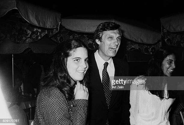 Alan Alda with his daughters Elizabeth and Beatrice at an outside event circa 1970 New York