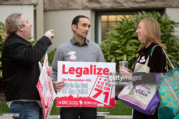 Alan Amsterdam and Cesar Maxit volunteers with the DC Cannabis Campaign talk to a voter about the ballot initiative to legalize marijuana in front of...