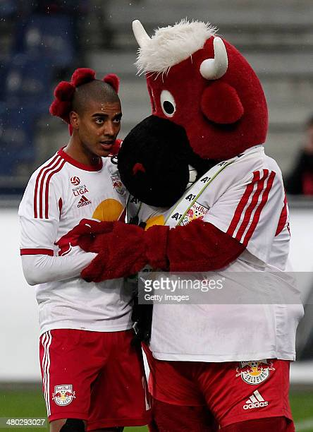 Alan and the mascot of Salzburg celebrating after the third goal for Salzburg during the tipp3 Bundesliga match between Red Bull Salzburg and SC...