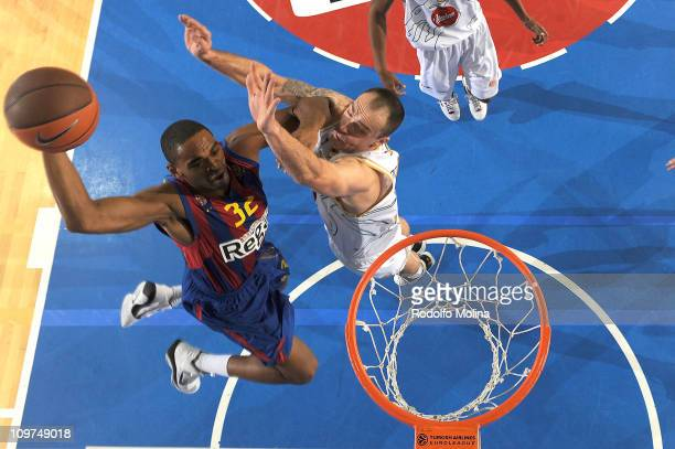 Alan Anderson #32 of Regal FC Barcelona competes with Damir Markota #22 of Union Olimpija during the 20102011 Turkish Airlines Euroleague Top 16 Date...