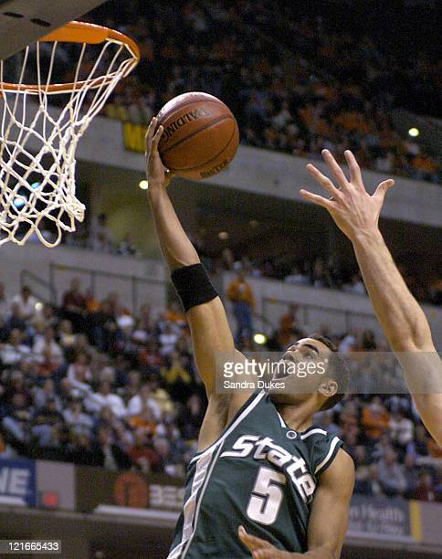 Alan Anderson lays the ball up over the outstretched arm of Mike Wilkinson in the first half of Wisconsin's 68-66 win at 2004 Big Ten Men's...