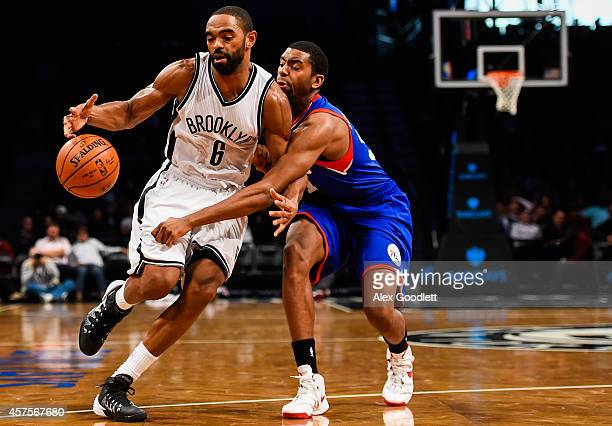Alan Anderson of the Brooklyn Nets attempts to drive past Hollis Thompson of the Philadelphia 76ers in a preseason game at the Barclays Center on...