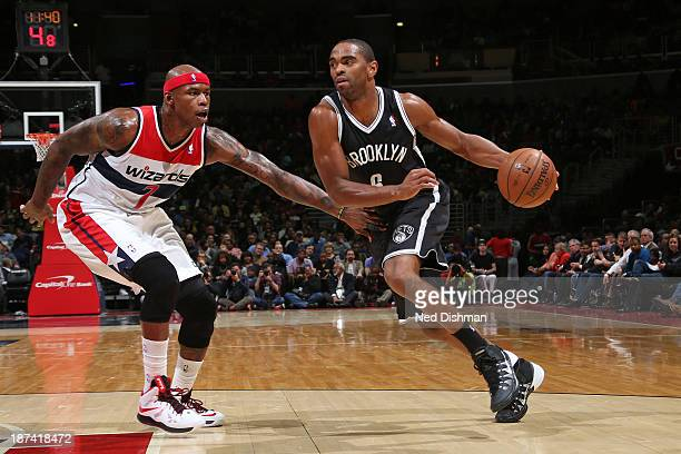 Alan Anderson of the Brooklyn Nets drives against Al Harrington of the Washington Wizards during the game at the Verizon Center on November 8 2013 in...
