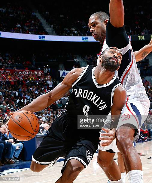 Alan Anderson of the Brooklyn Nets drives under Al Horford of the Atlanta Hawks at Philips Arena on January 28 2015 in Atlanta Georgia NOTE TO USER...